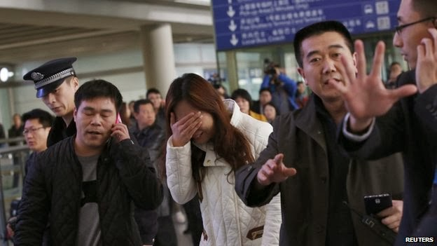 Relatives of passengers have faced an anxious wait at Beijing International Airport
