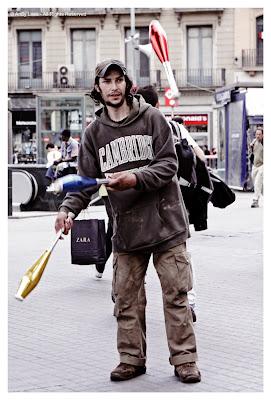 street performer juggler beggar
