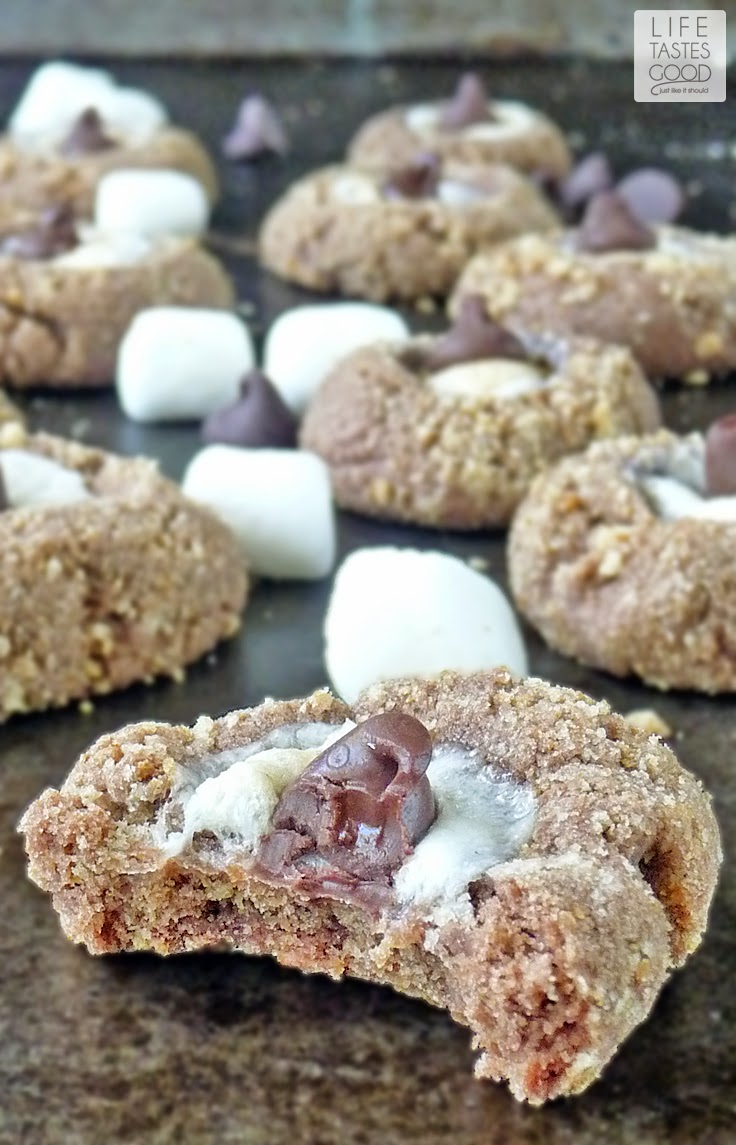 S'more Cookie Recipe | by Life Tastes Good | Fun chocolate cookies rolled in graham cracker crumbs and topped with a mini marshmallow. All the flavors of a traditional s'more rolled into an easy-to-make cookie. No open fire required!