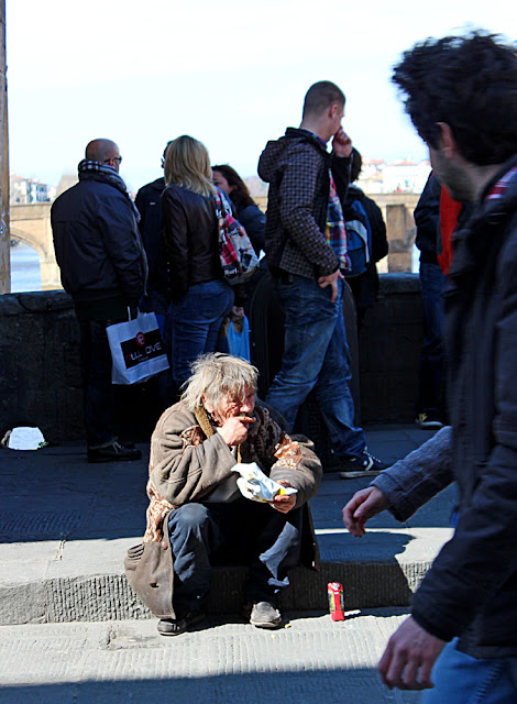 tramp eating on street-side