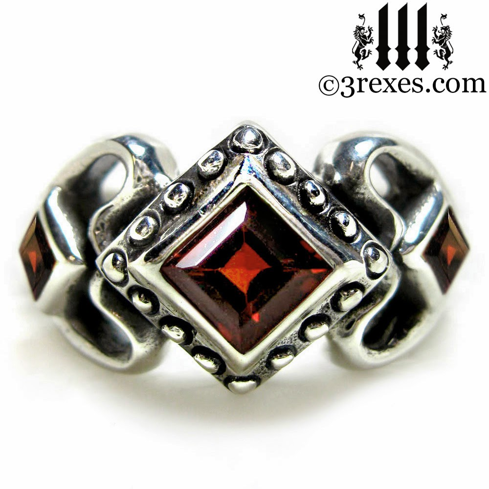 princess love gothic engagement ring with garnet stones