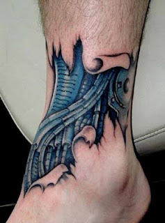biomechanical tattoo on the ankle