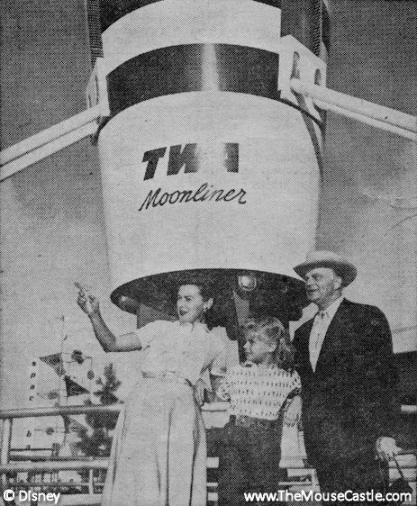 Edgar Bergen and his family in front of the TWA Moonliner at Disneyland, March 1956