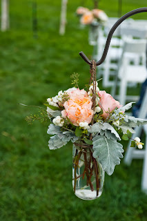 Les Fleurs : Barn at Gibbet Hill : Sarah Bastille Photography : sheppards hook with mason jars for aisle decor