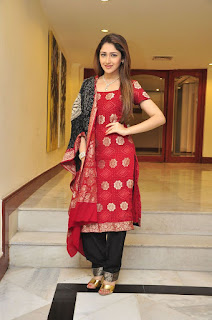 Sayesha Saigal in Red Kurti and Black Paijama at Akhil Movie Pre Release Interview