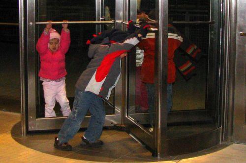 Image result for kid in revolving doors