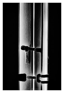 Black and white window shutters showing light and darkness