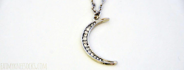 Close-up of the rhinestone-studded crescent moon necklace from Born Pretty Store.