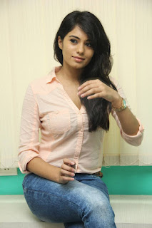 Deepa Sannidhi in Spicy Transparent Peach Shirt and Denim Jeans Stunning Smiling Beauty