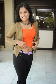 Vrushali in Lovely Orange Tank Top and Denim Jeans with a Beautiful Pink Belt and Grey Neckless