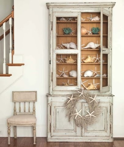 coastal collection in glass cabinet