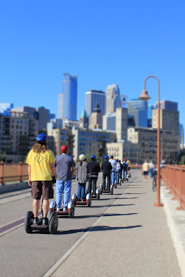 segway riders on the stone arch bridge