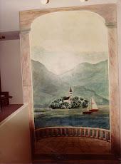 Trompe l'oeil doorkijkje met kerkje op een eilandje