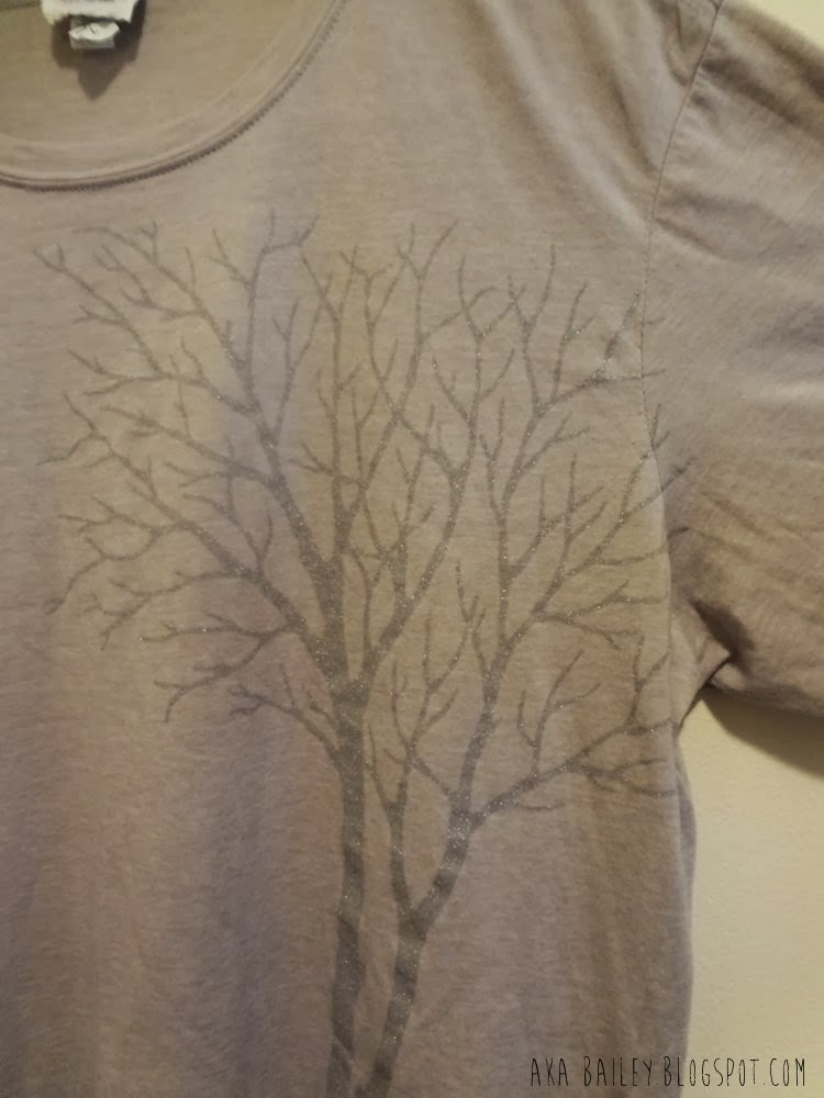 Close up of tree graphic on a Belvedere Vodka t-shirt