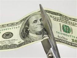 Scissors cutting money