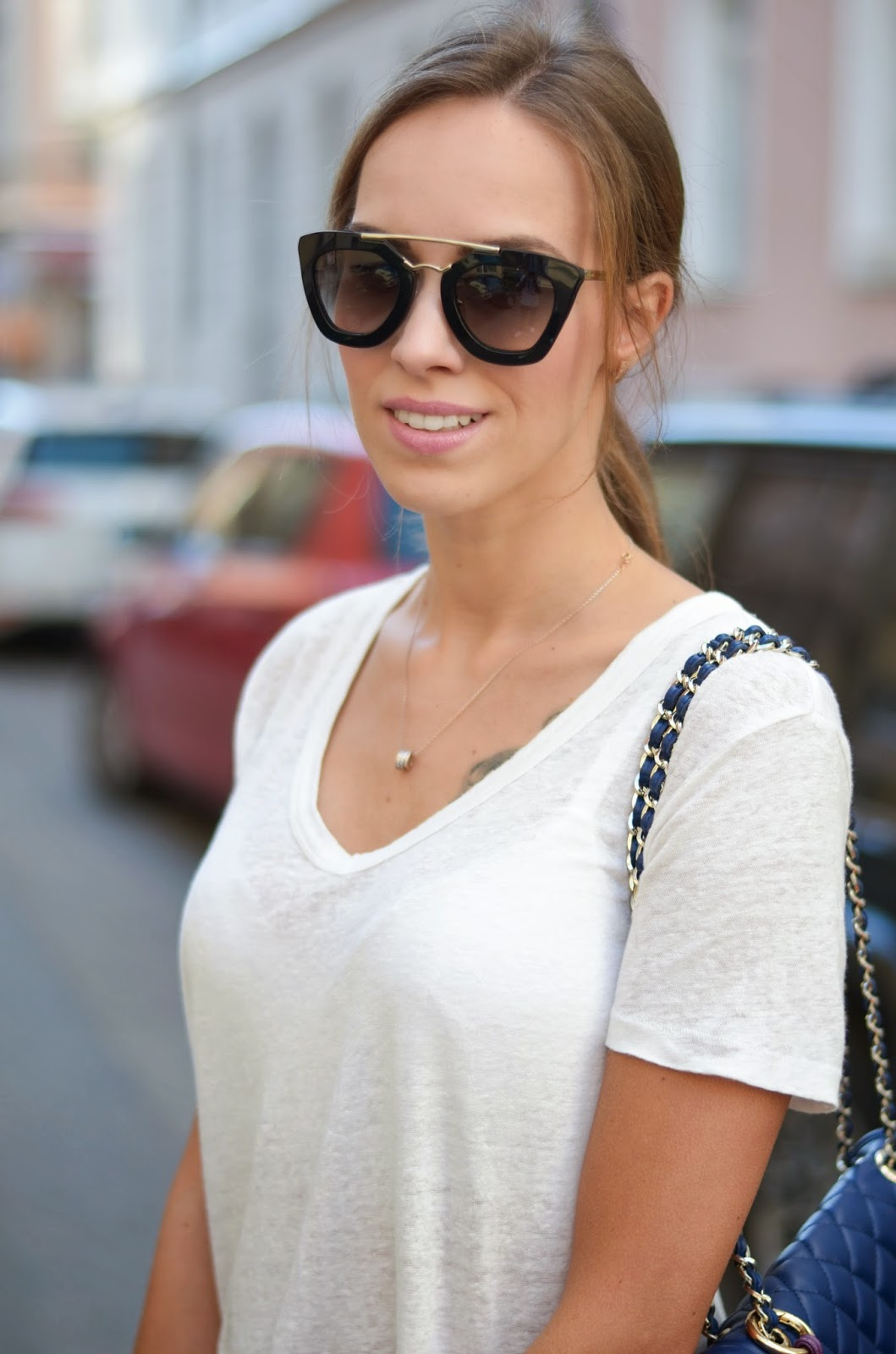 kristjaana mere white t-shirt prada black retro sunglasses moschino blue bag