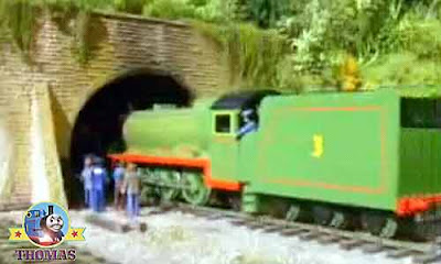 Thomas and friends Henry the tank engine rolled forward along iron tracks murky rail tunnel entrance