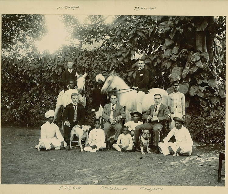 Group Photograph of Indian and European Men with Children and Dogs - c1900's