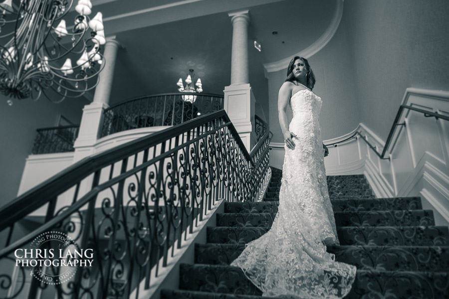 stunning bride in elegant wedding dress standing on spiral staircase inside the clubhouse at River Landing