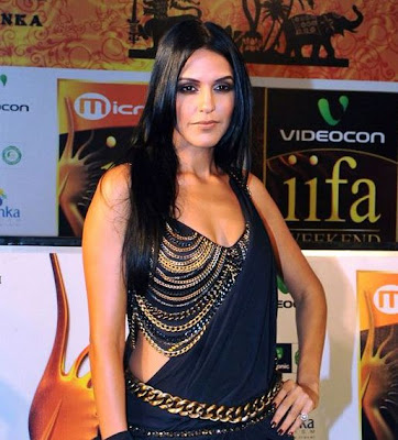 Neha Dhupia Long Center Part Straight Hairstyle