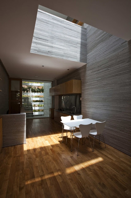 Interiors of first floor of green home with wooden walls and floor