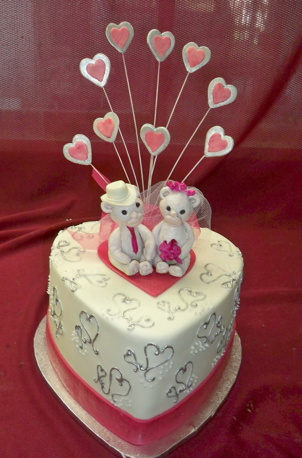 Silver hearts and hot pink ribbon with teddy bear cake