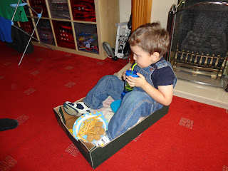 Big Boy in his Cardboard Box Car having his Drive Through Lunch