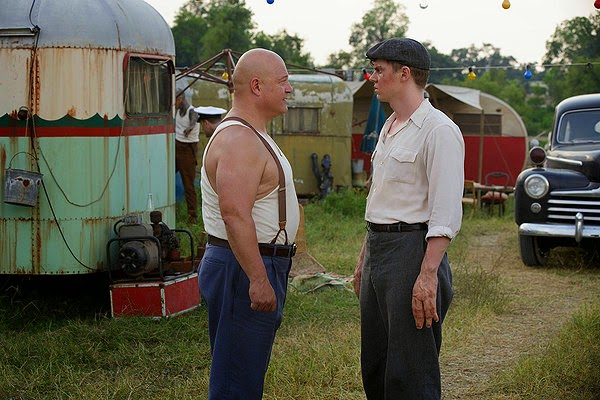 Michael Chiklis and Evan Peters as strongman Dell Toledo and Jimmy Darling in American Horror Story Season 4 Episode 2 Massacres and Matinees