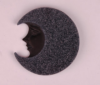 Carved moon face in black agate with sparkly drusy
