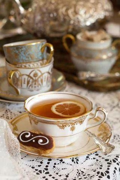 tea time: vintage and romantic tea cup with cookies