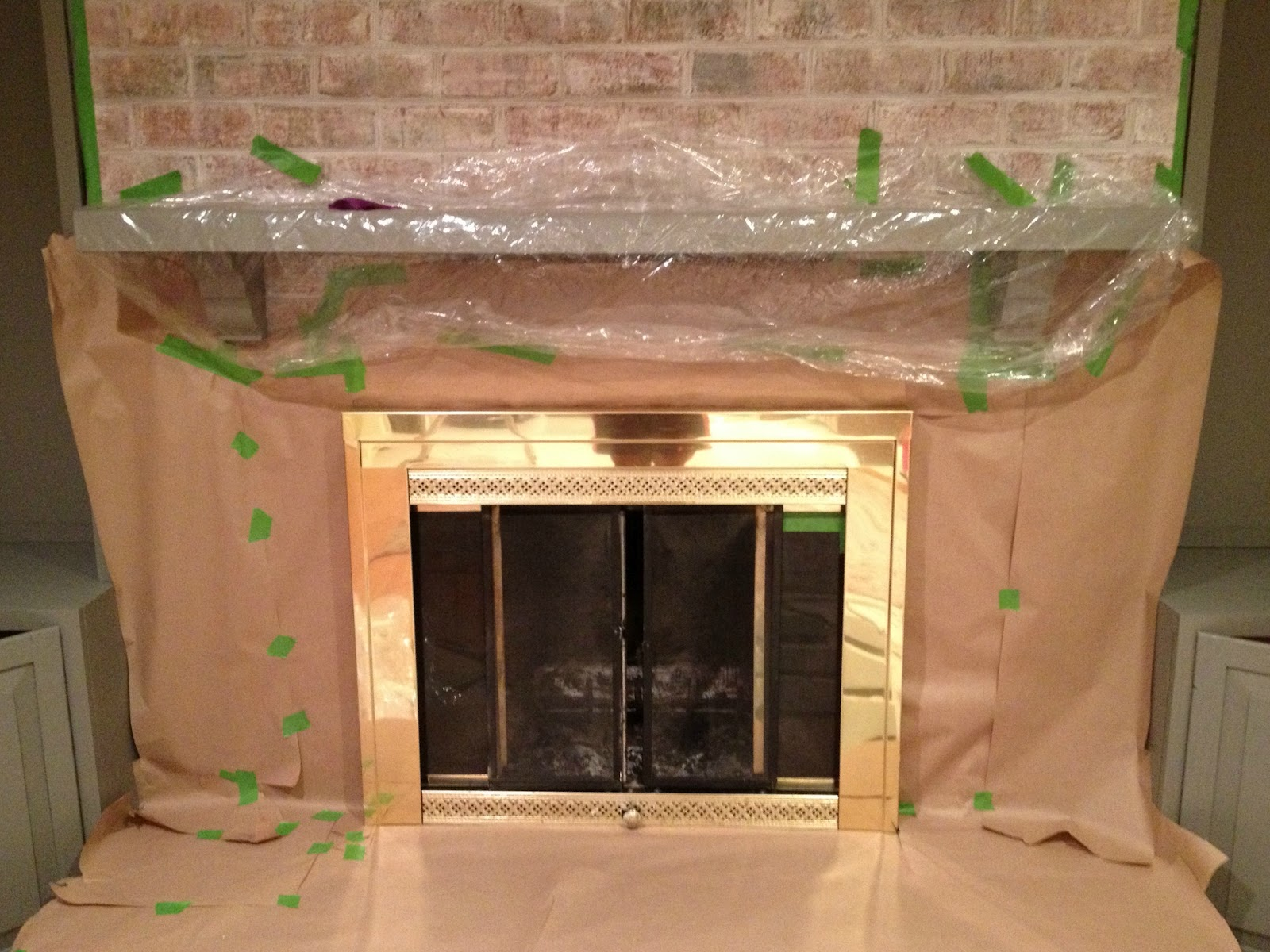 Brass fireplace update east coast creative blog for the glass doors we used more tape and paper i found that if i used a spatula i could get the tape really close to the edges for a perfect eventshaper
