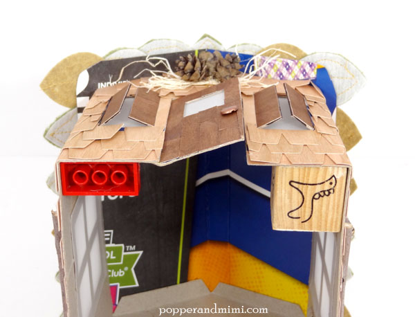 Stabilize the corners of a chipboard house with blocks | popperandmimi.com
