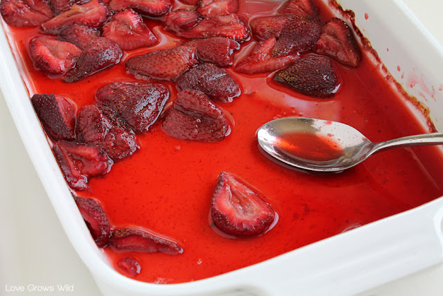 LoveGrowsWild.com | Add this delicious homemade Roasted Strawberry Topping to your ice cream, waffles, or yogurt! Perfect for catching overripe berries just in time!