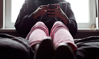 Teen on the phone - Guardian image.