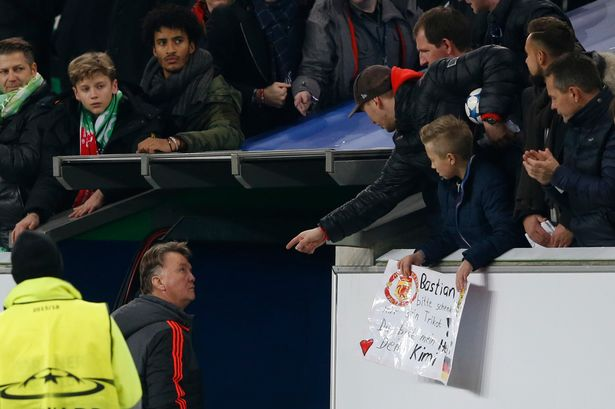 Frustrated: Manchester United manager Louis van Gaal walks down the tunnel at the end of the match as fans gesture