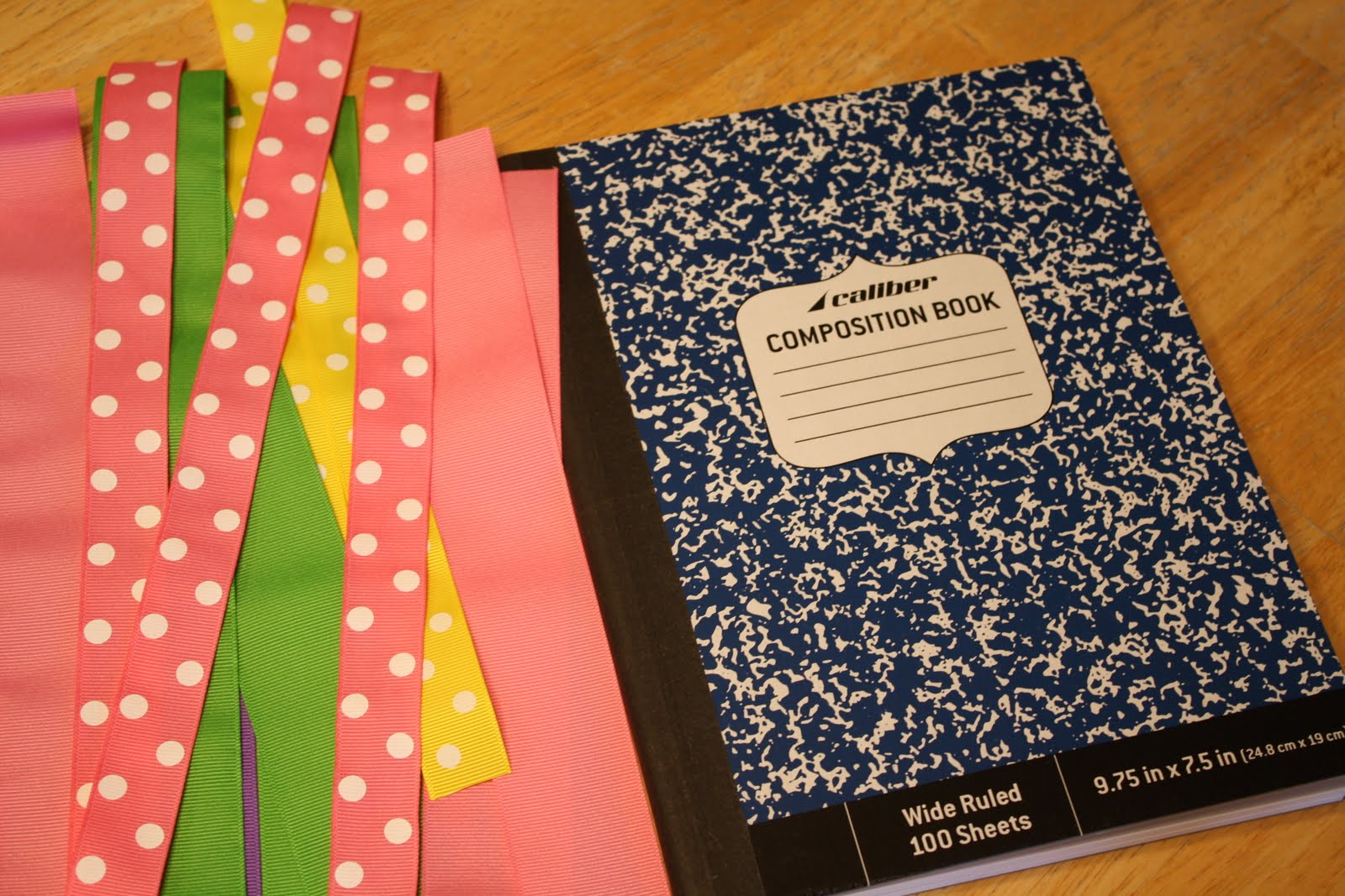 One preppy cookie tutorial back to school do it yourself first cut ribbon into strips long enough to stretch the length of the notebook with about one inch extra ribbon on either side solutioingenieria Images