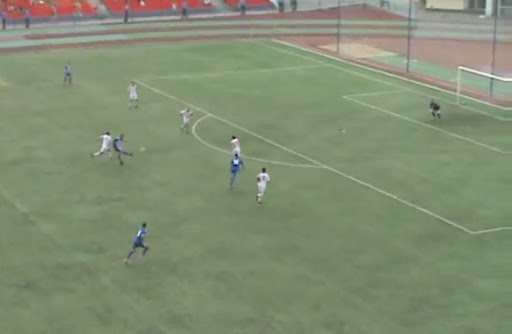 Sokol Saratov player Evgeny Shcherbakov shoots to score from long range against Spartak Tambov