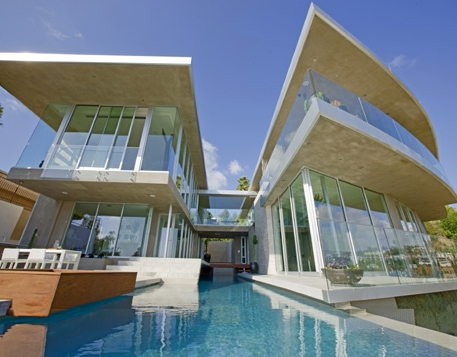 Photo of incredible modern home s seen from the pool