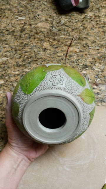 Ceramic pottery vessel by Lily with leaf imprints, in progress.