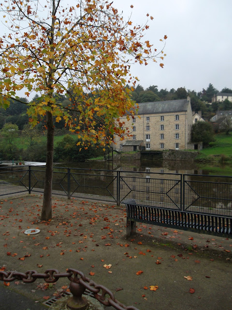 Autumn colours on tree. River/canal de Nantes a Brest. Watermill overlooks.