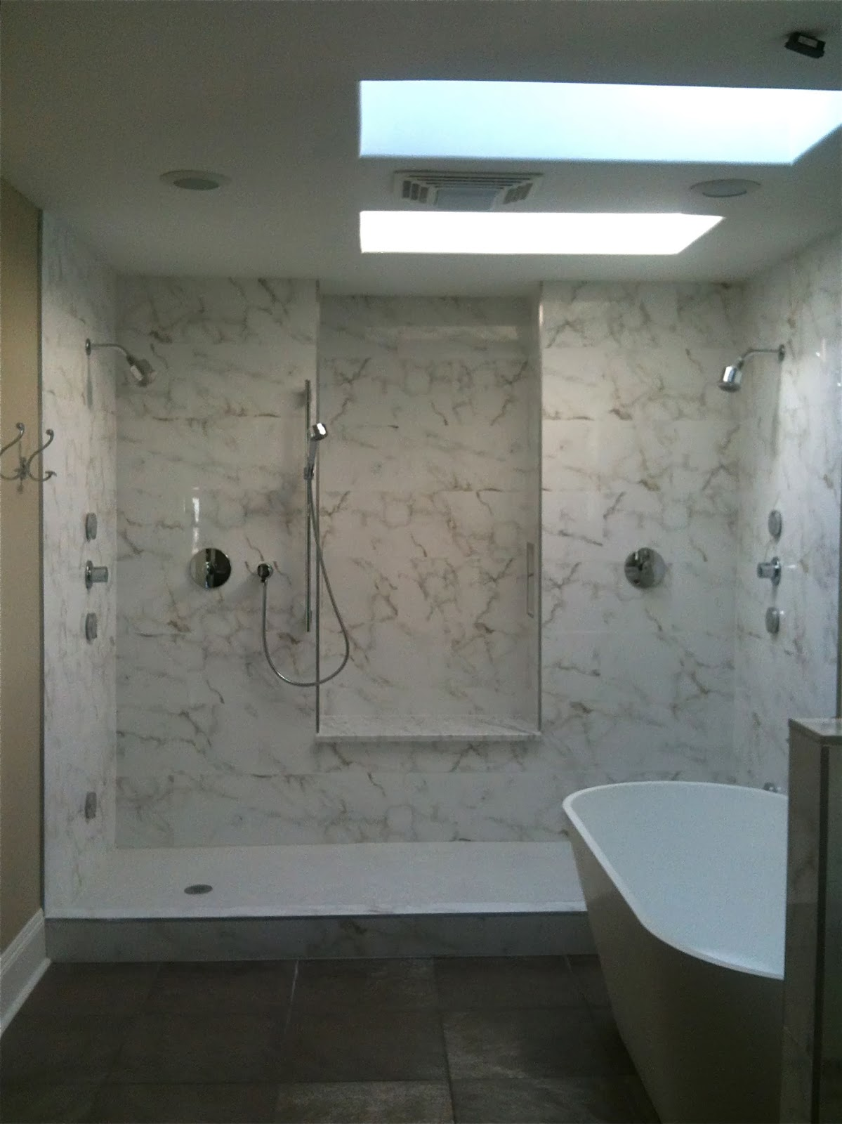 Bath Tubs Are Out Sort Of  T H E  V I S U A L  V A M P - 3 knob shower faucettile designs for walk in showers