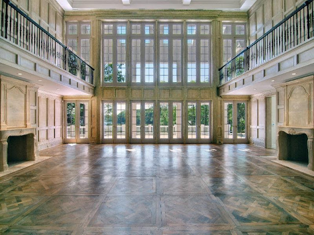 Estate Hamptons parquet floors and oak paneled walls