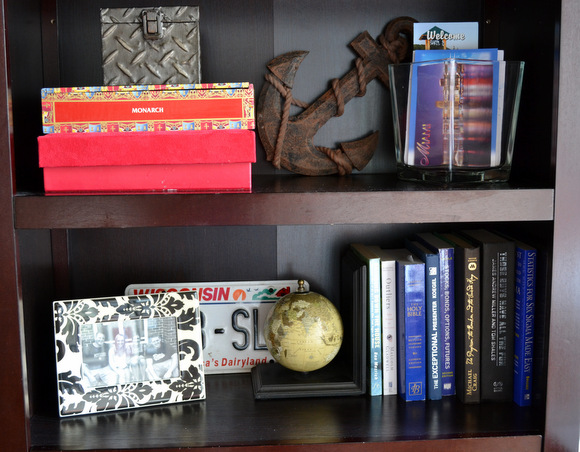 Bookshelf with books and anchor