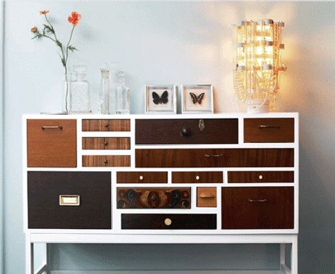 The various drawers with different wood stains in this dresser compliment the white paint.