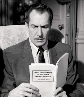 Vincent Price is absorbed in some frightening literature