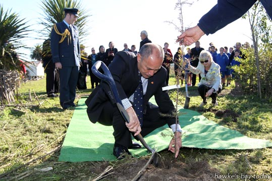 L-R: FLTLT Kyle Newman, aide-de-camp; Governor-General Lt Gen Rt Hon Sir Jerry Mateparae, Lady Janine Mateparae, planting a totara tree and a kowhai tree at Operation Patiki, a project at Kohupatiki Marae, Kohupatiki, Hastings. photograph