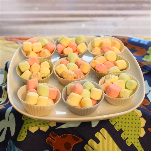 Dinosaur party food marshmallow eggs in silicone cupcake nests