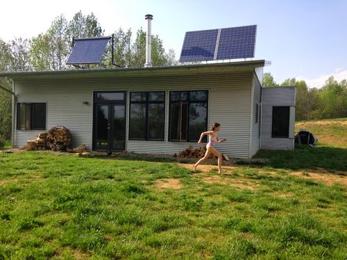 Passive solar off grid modern prefab embraces love and art for Passive solar prefab homes