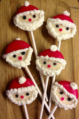 Babybel cheese put on sticks and decorated to look like Santa