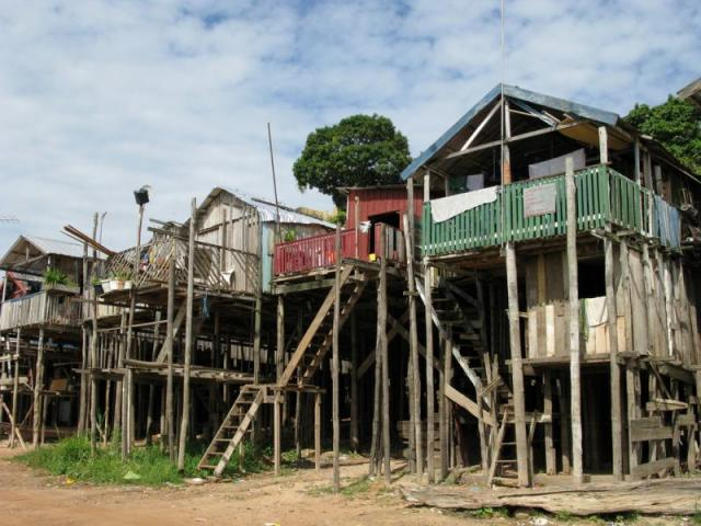 Rio negro becomes the amazon manypeople build their homes on stilts